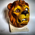 Quick one ,  plastic tiger mask over ceramic cow head with creepy eyes.