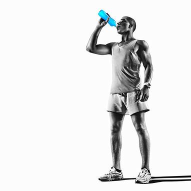 Young muscular build man silhouette drin