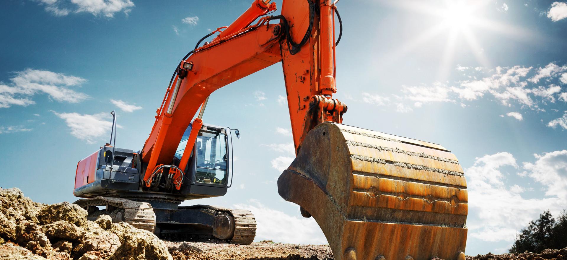 Crawler excavator front view digging on