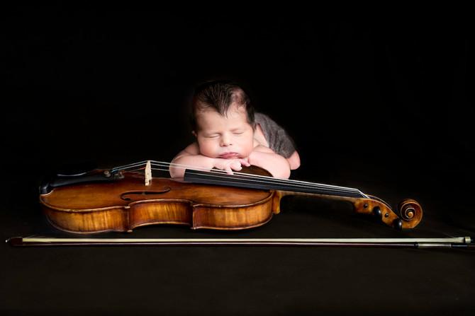 The Newborn and his Violin