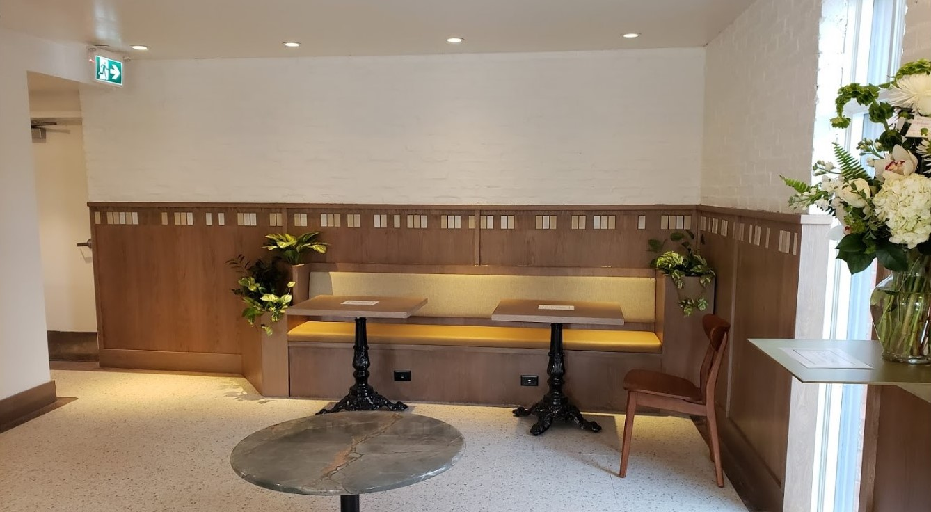 custom woodwork for seating in Deville Coffee