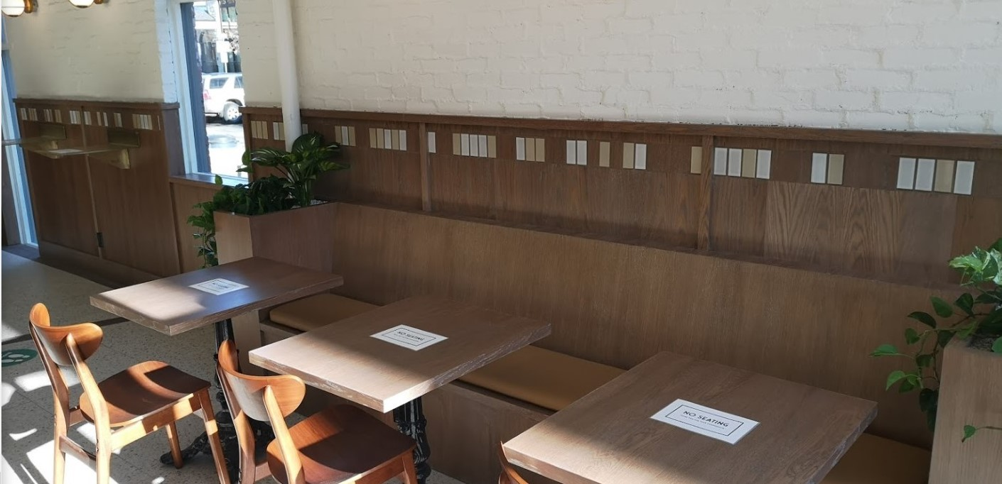 custom woodwork square seating in Deville Coffee