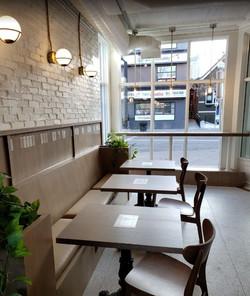custom woodwork seating in Deville Coffee