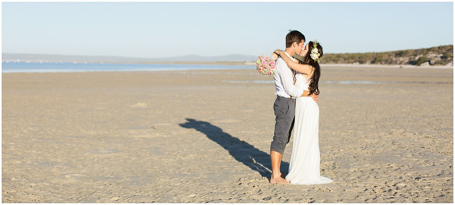 bohemian wedding couple kissing
