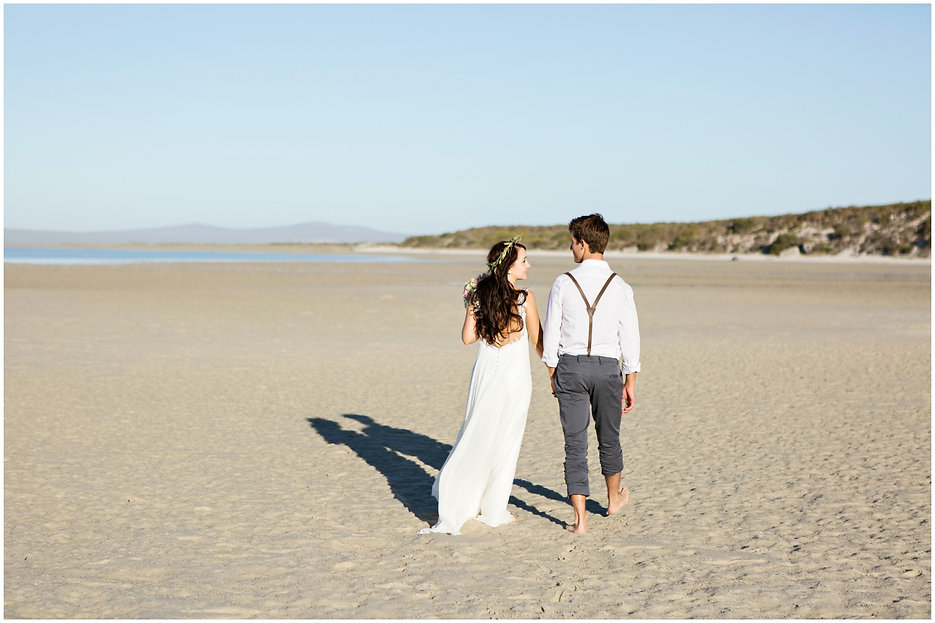 bride and groom walk on beach, barefoot bride and groom walking on the beach