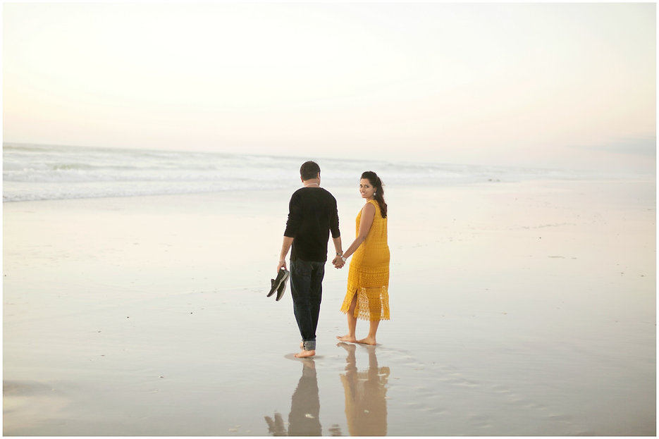 dreamy imange of couple walking on the beach