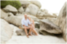 engagement shoot couple sitting on boulders, clifton beach, cape town