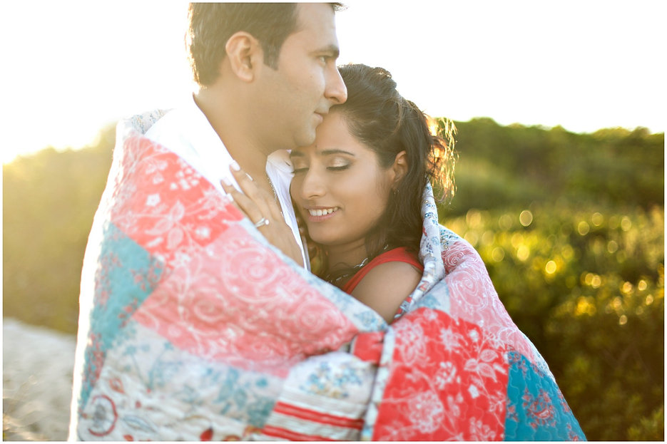 sunset couple shoot, couple wrapped in a colourful quilt