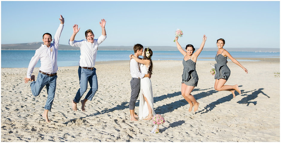 bridal party, jumping, beach, bridal party photos on the beach