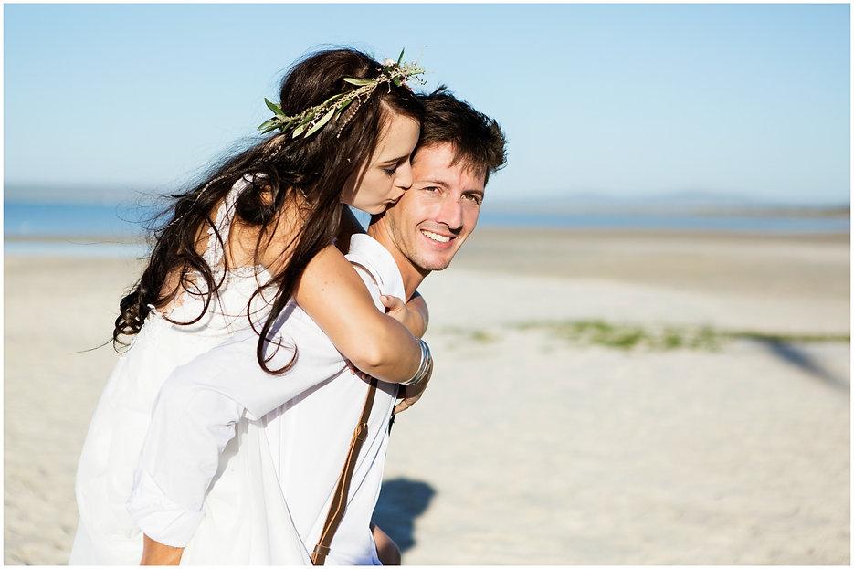bride and groom bohemian beach wedding, kiss on cheek