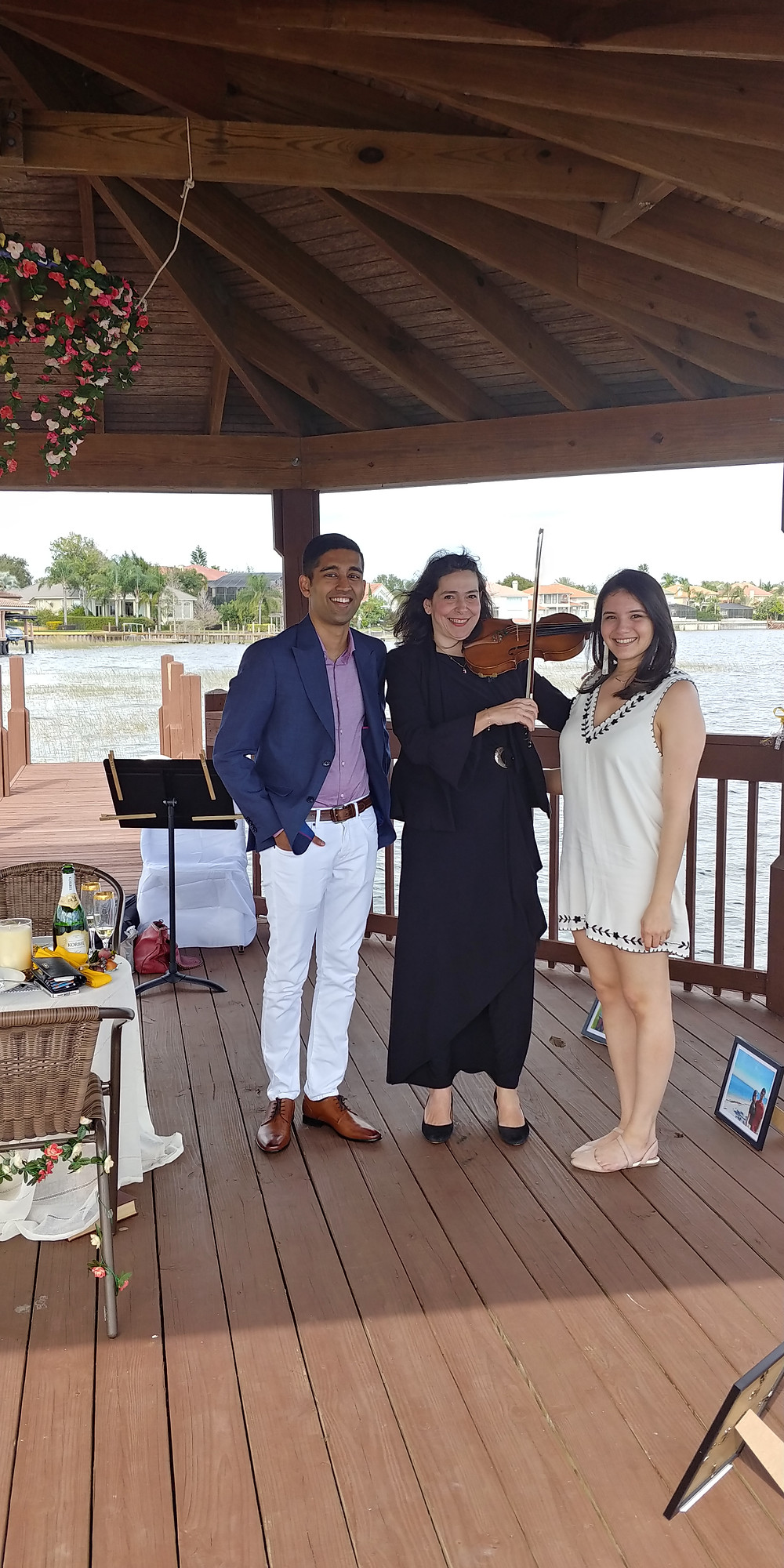 Engaged couple and Pepina with violin
