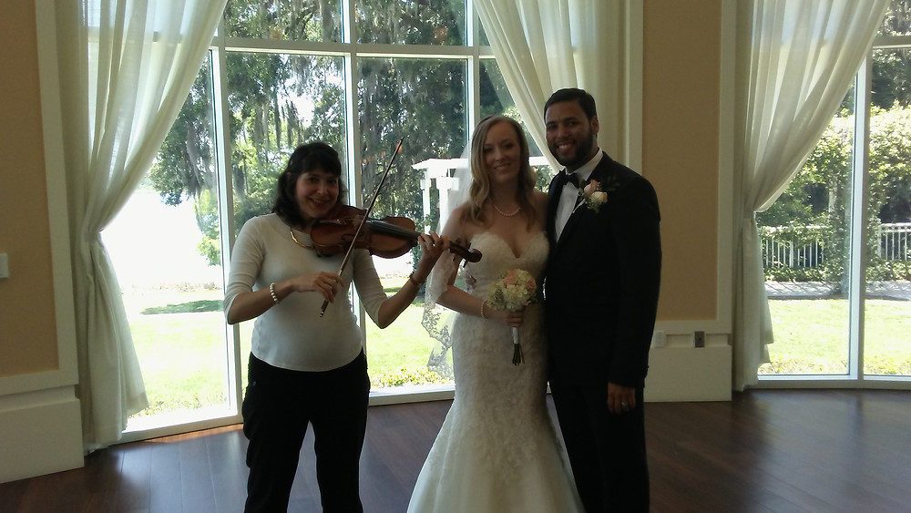 This wedding was in a beautiful Country club in Lake Mary, FL. Outside of this amazing Country club there is a huge green field with the trees, plants, and flowers. During the ceremony I played the classical music and during the cocktail hour I played a mix of the pop and classical music repertoire. There was also a Latin spirit because both families are Latin or have this origin. During the cocktail hour there was some dancing as well. The ceremony was on the high end-meaning it was very well organized. I enjoyed playing it!