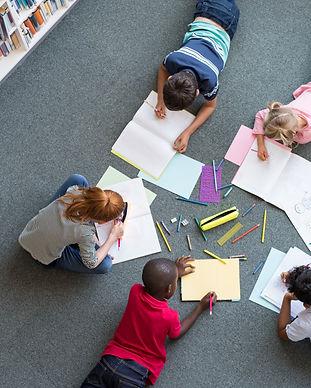 Elementary children lying on the floor a