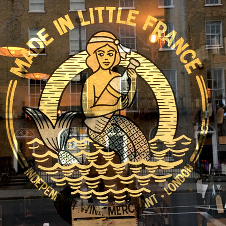 Made in little france wine shop gilded window