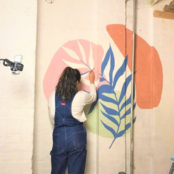 Artist painting wall