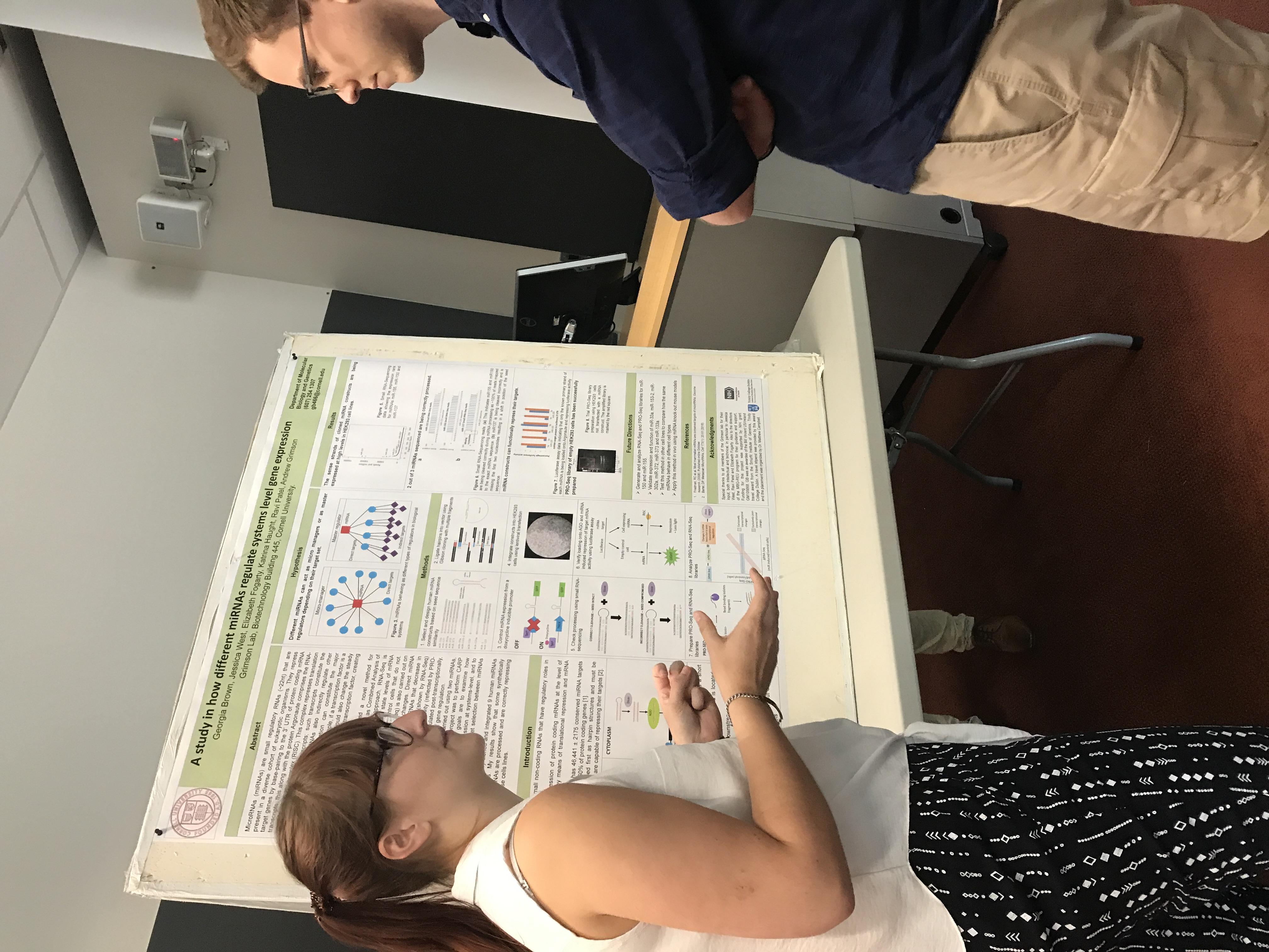 Georgia presenting her REU poster.