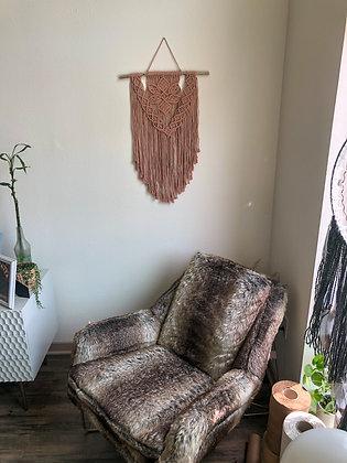 Spring wall hanger