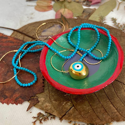 CATCHY EVIL EYE NECKLACE