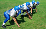 Football playrs at the line of scrimmage