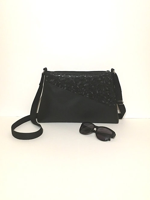 Elegant black faux leather handbag
