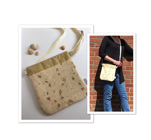 Small crossbody purse with footprints in sand