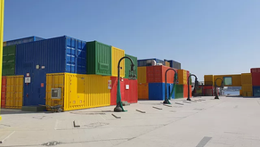 An eclectic street with shops housed in colourful containers