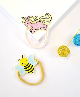 Sveta's Kidswear Bee and Unicorn Headbands.