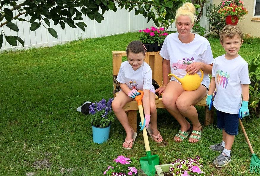 Family Gardening in White Matching T-shirts.