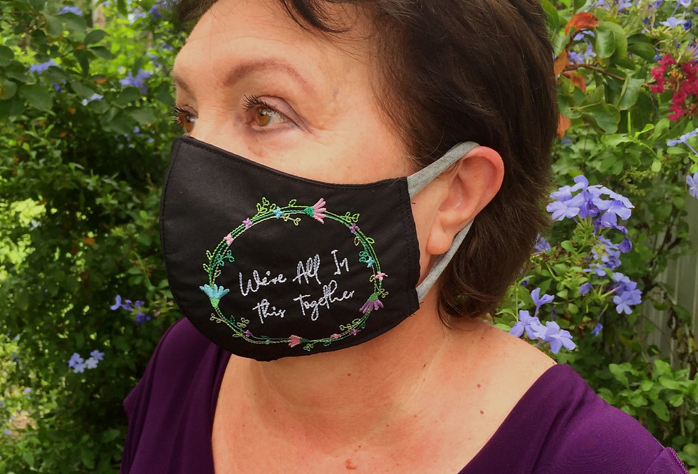 A woman wearing Sveta's Kidswear embroidered, face mask black color