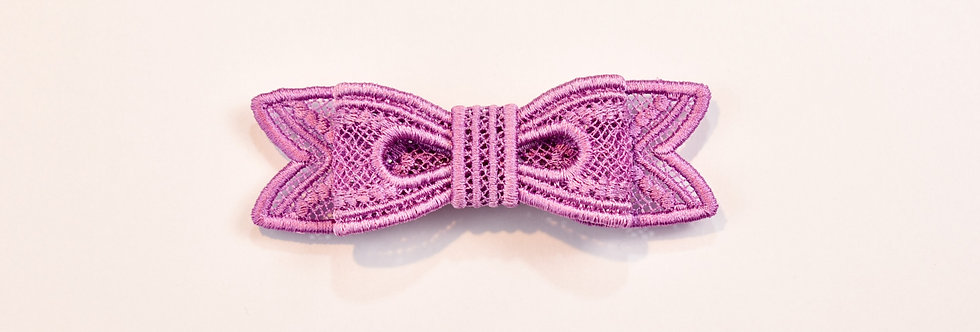 Sveta's Kidswear classic lace bow hair accessory in purple color front view