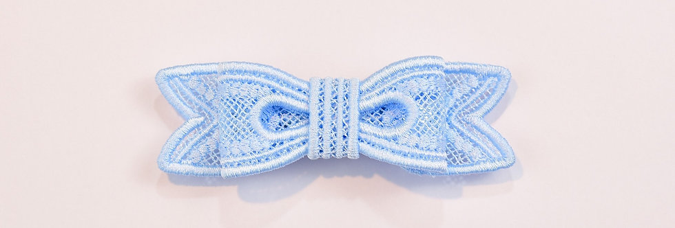 Sveta's Kidswear classic lace bow hair accessory in light blue color front view