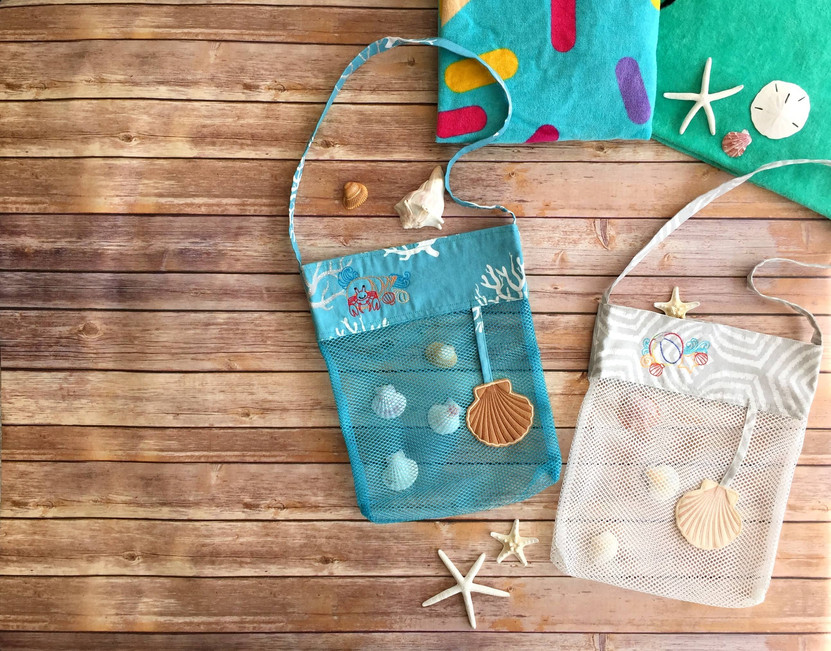 Sveta's Kidswear sea shells bags, caribbean blue & white, with embroidered elements.