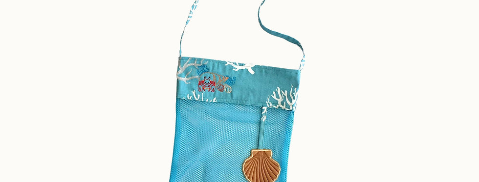 Mesh Bag for Sea Shells, Caribbean Blue with Embroidered Elements.