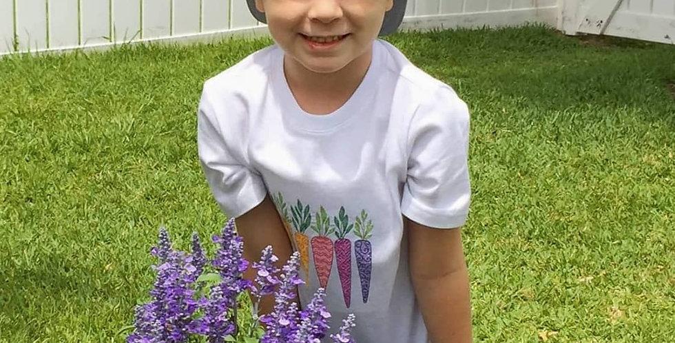 A Boy Wears Carrots Embroidered T-shirt from Sveta's Kidswear.