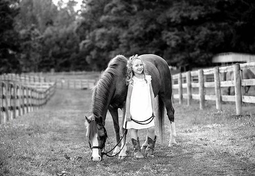 girl with horse on farm