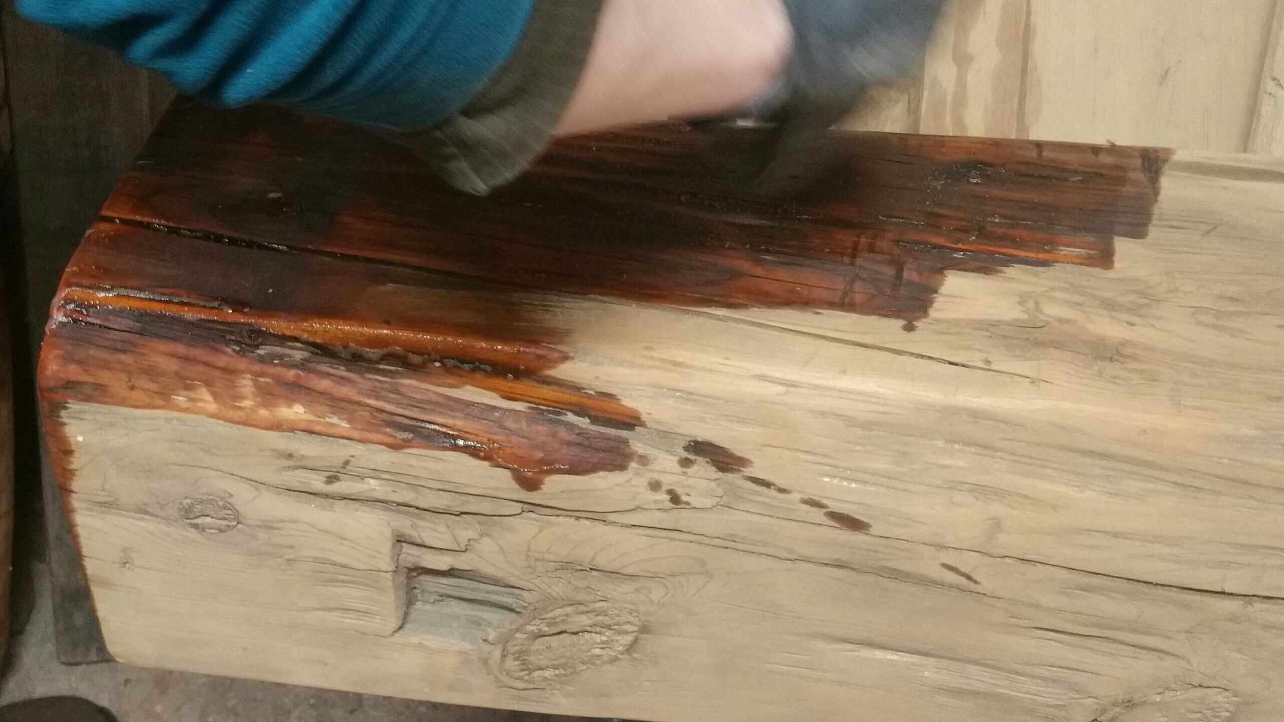 hand hewn beam getting oiled