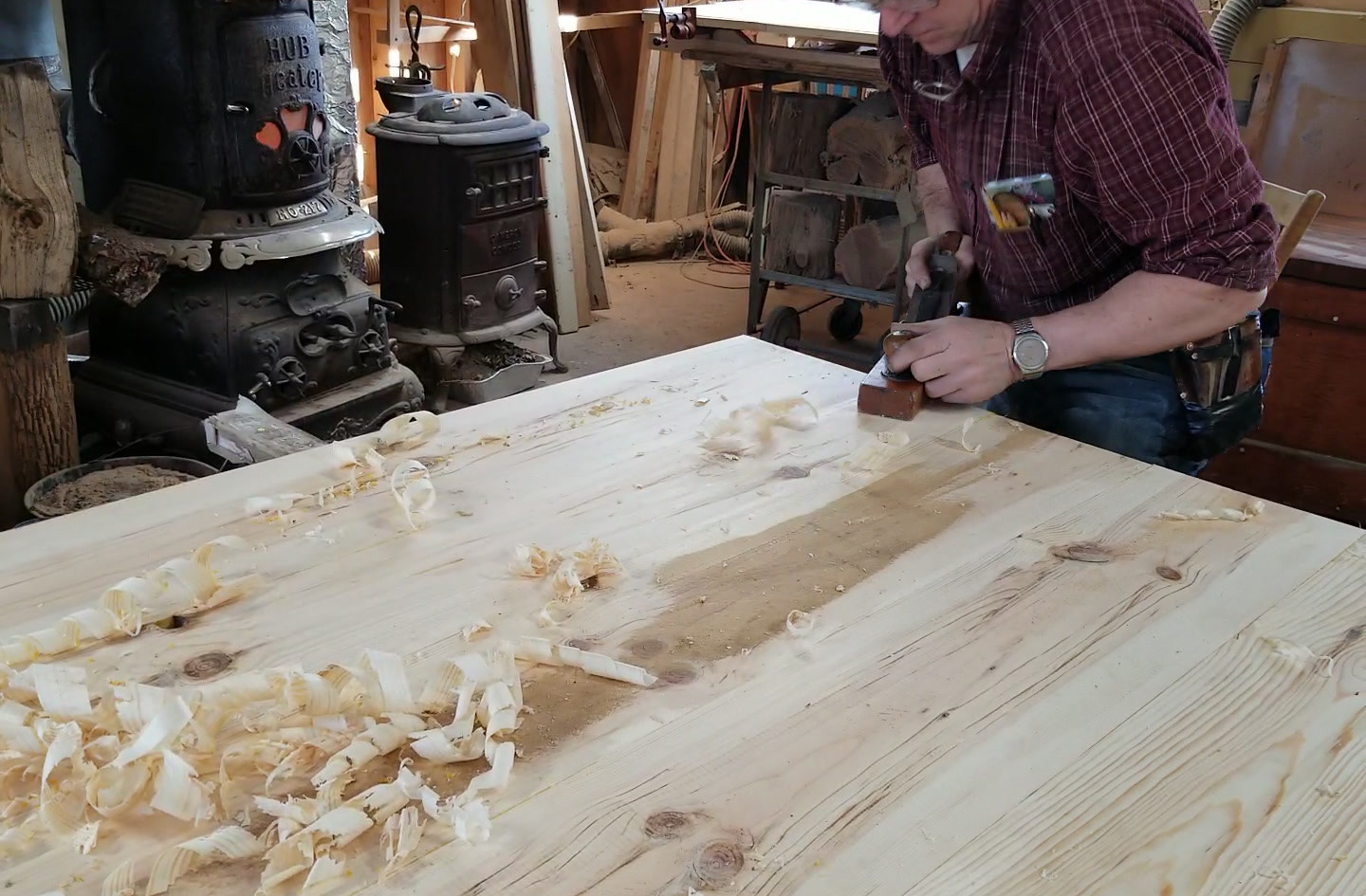 hand planing our Norway Hard Pine table