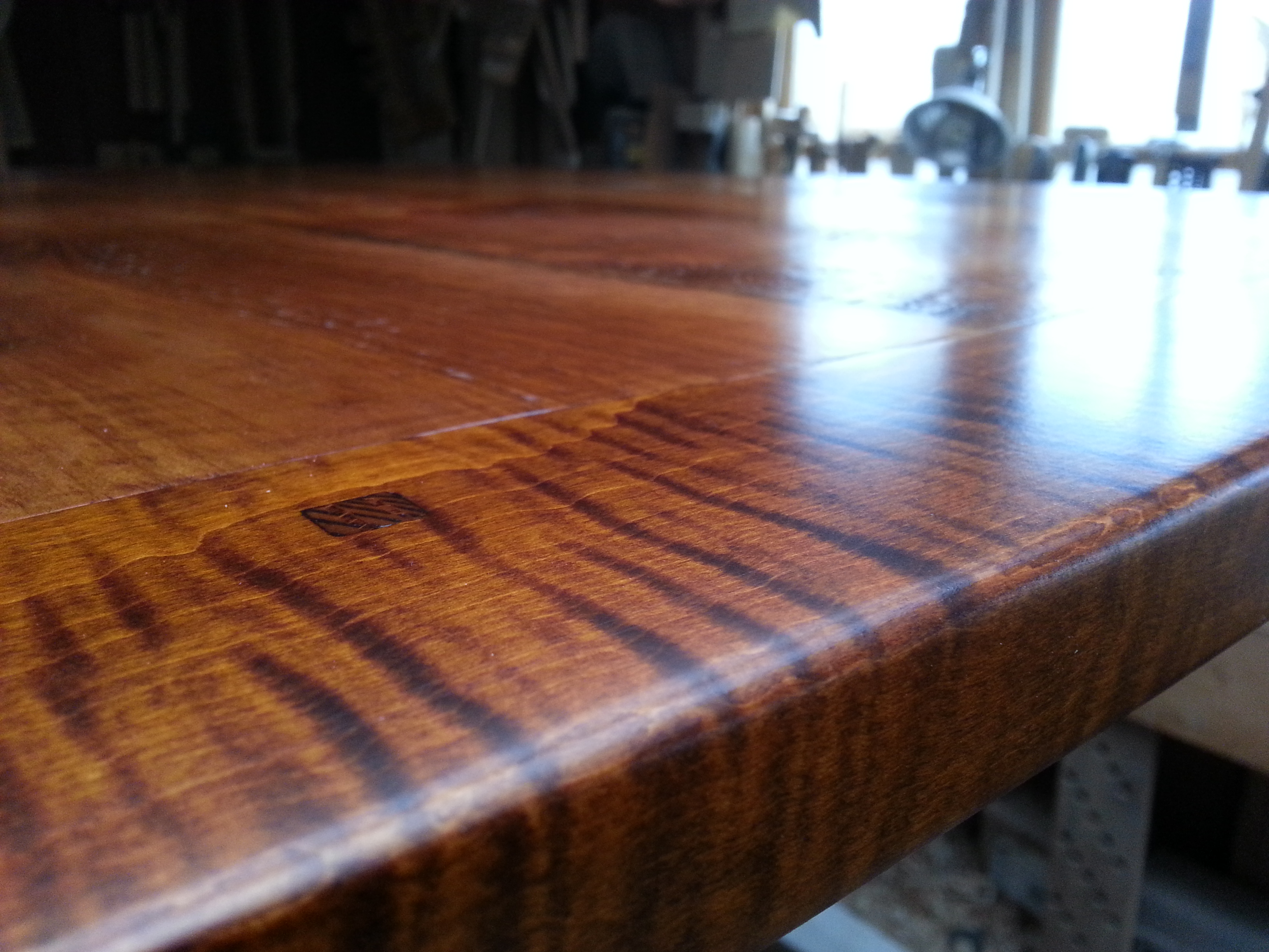 Reclaimed wood top with Tiger Maple