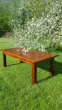 Thick top, timber leg far, table
