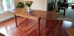 reclaimed Pine top  table with end leave