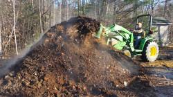 Jim turning compost