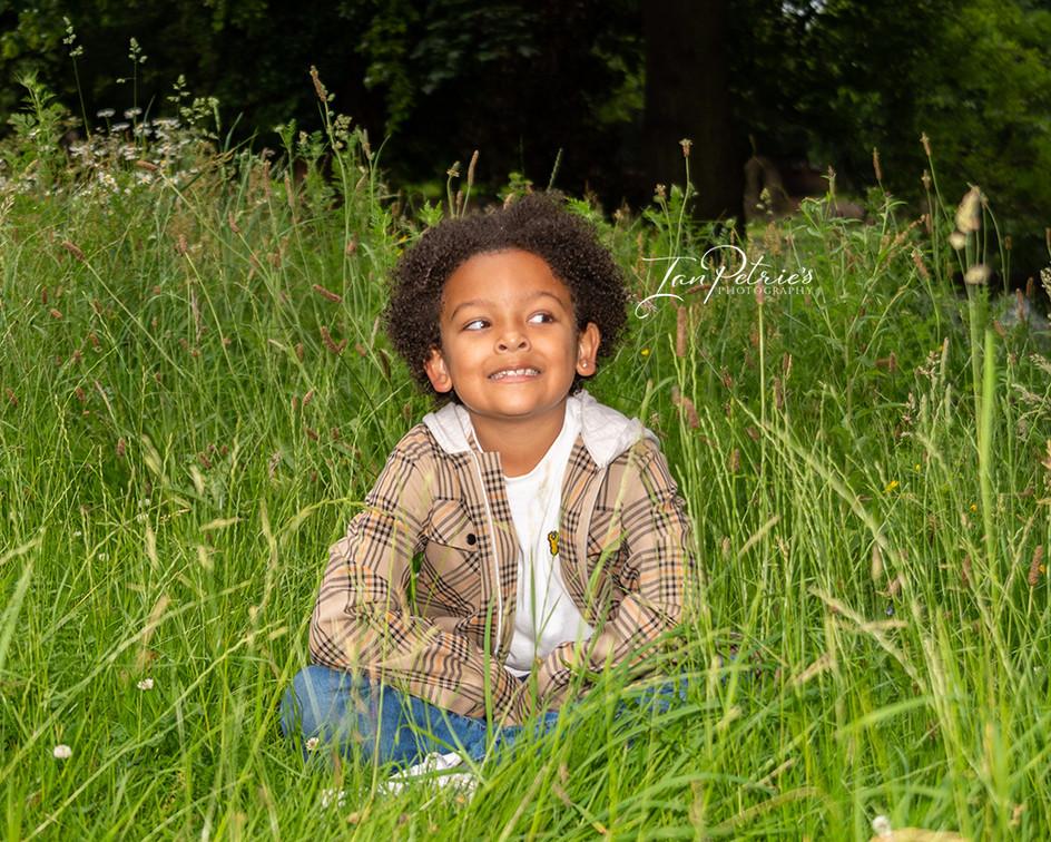 Nottingham & Derby Portrait photographer - child in the long grass