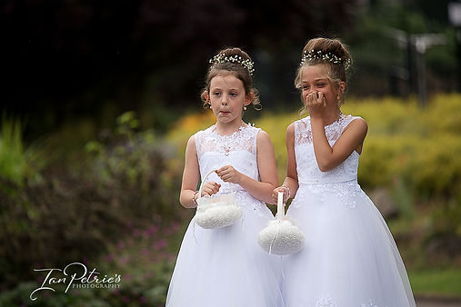 Nottingham & Derby Wedding Photographer capturing 2 flower girls walking to the ceremony at Carr Bank wedding venue in Mansfield