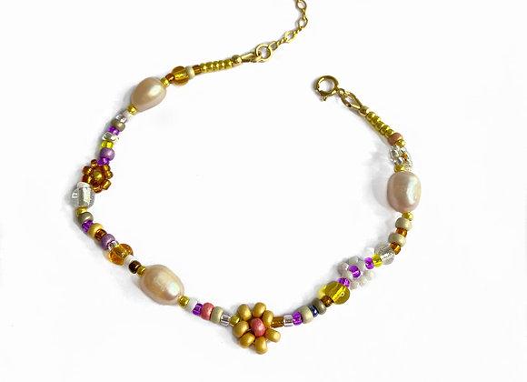 bracelet perle fleur jaune plaqué or