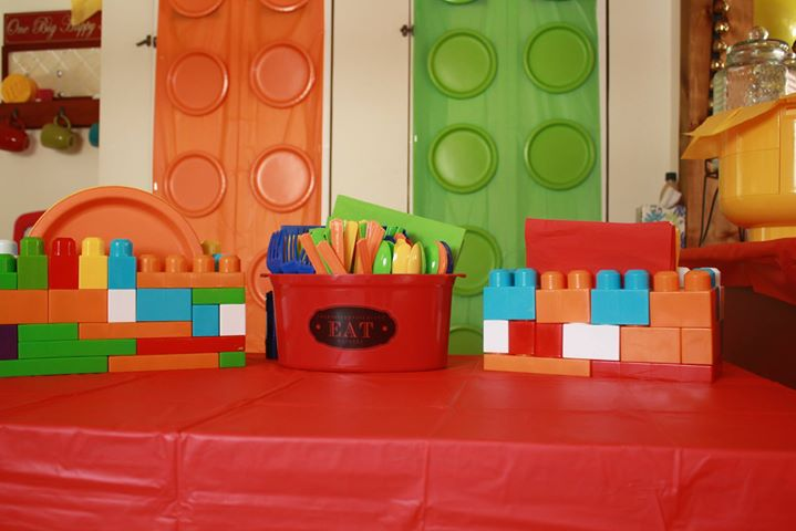 Cael couldn't wait to build the paper plate and napkin holders out of duplos