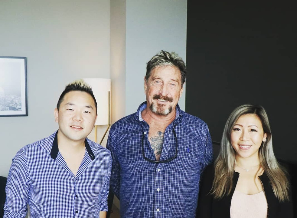 Vinson Leow and Gabriel Yue with John McAfee