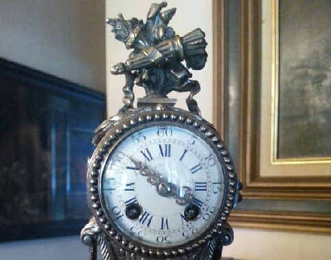 Atique silver resist french table clock.