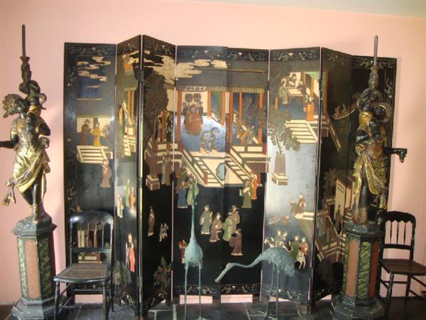 4 ft. Blackamoor statues in front of Asian screen