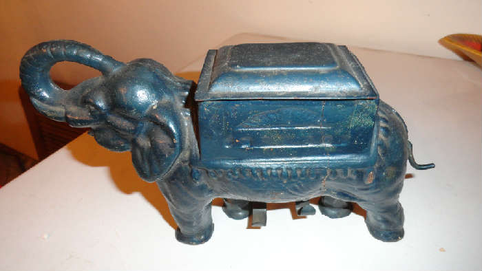 metal elephant that rolls cigarettes circa 1920