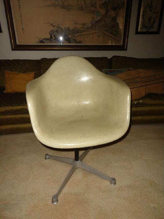 molded fiberglass chair dated 1958 tagged on bottom by Herman miller